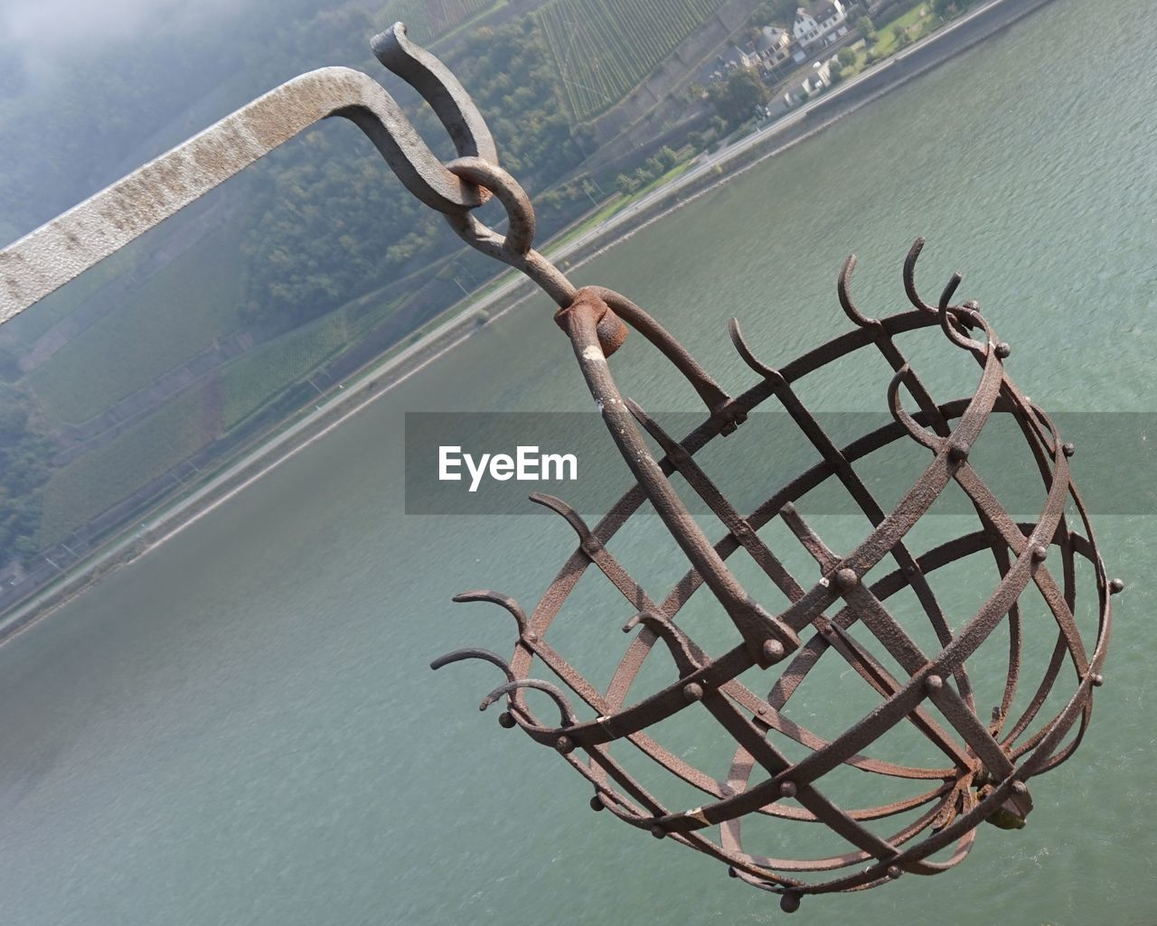 metal, no people, day, hanging, water, outdoors, lake, close-up, nature, sky