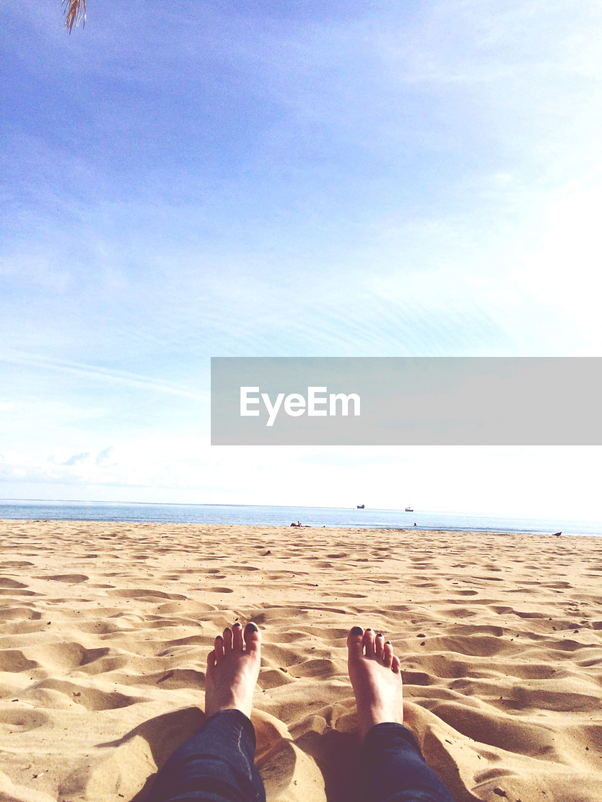 low section, person, beach, sand, personal perspective, lifestyles, leisure activity, sky, sea, human foot, men, barefoot, shore, vacations, water, relaxation
