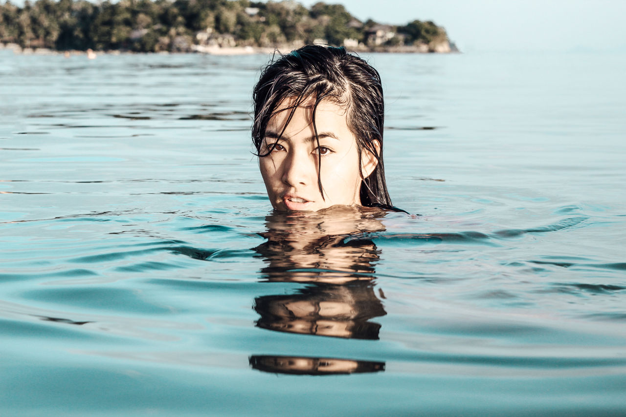 Portrait Of Young Woman Swimming In Sea