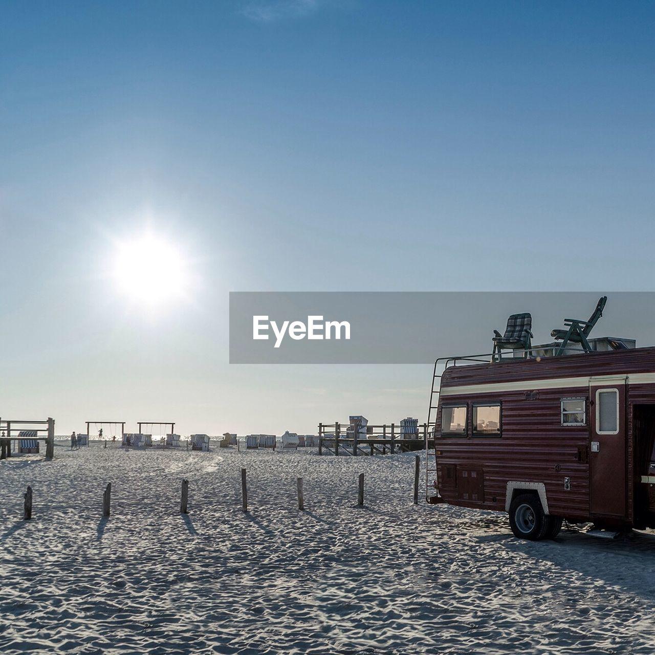 Side view of a camper van on snow covered landscape