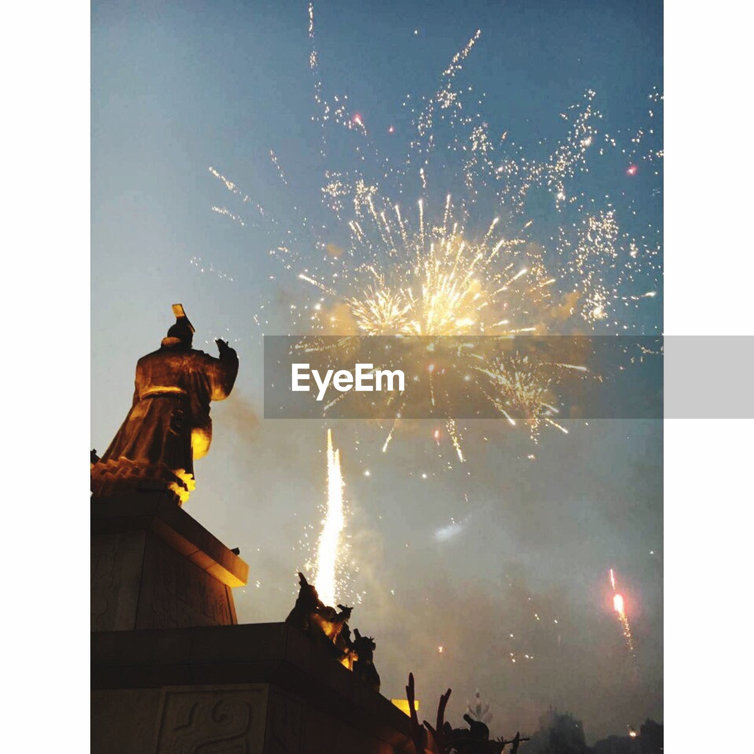 religion, architecture, spirituality, built structure, building exterior, low angle view, motion, place of worship, celebration, firework display, long exposure, church, glowing, exploding, firework - man made object, sky, sparks, outdoors, high section, steeple, outside, no people