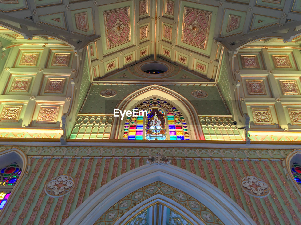 place of worship, religion, spirituality, architecture, built structure, low angle view, window, pattern, ornate, ceiling, arch, day, no people, multi colored, indoors
