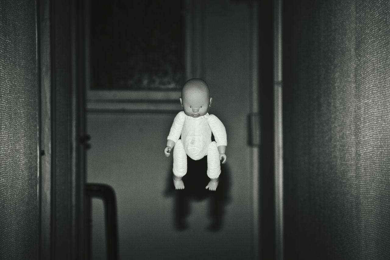 Doll In Mid-Air At Corridor