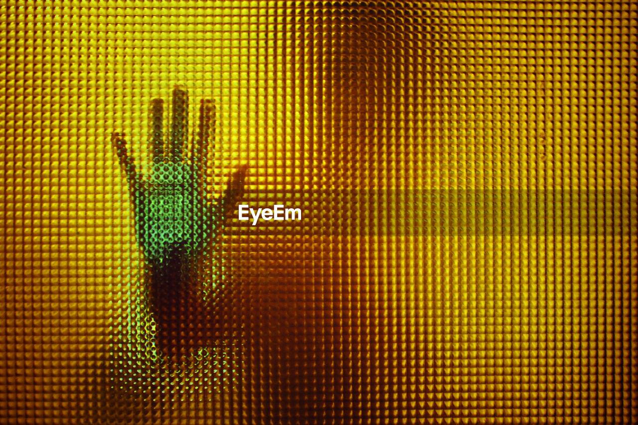 Human hand on glass