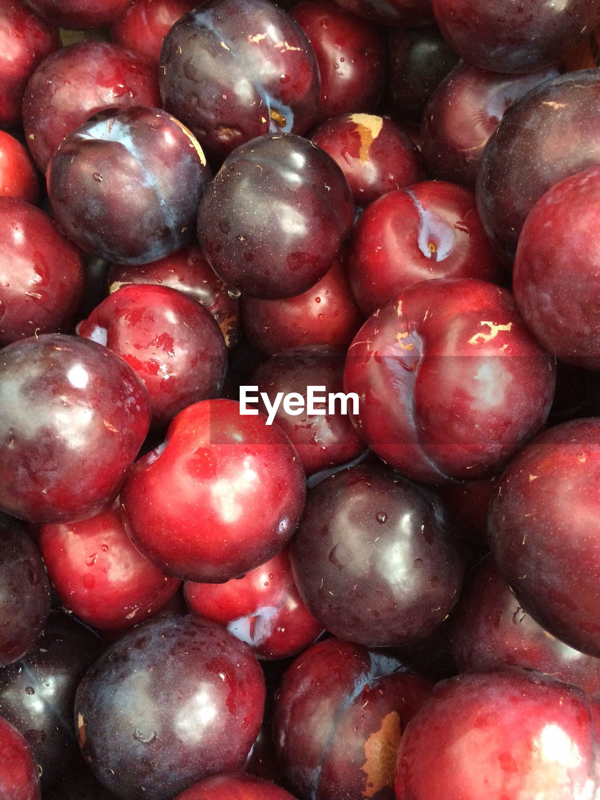Close-up view of stack of plums