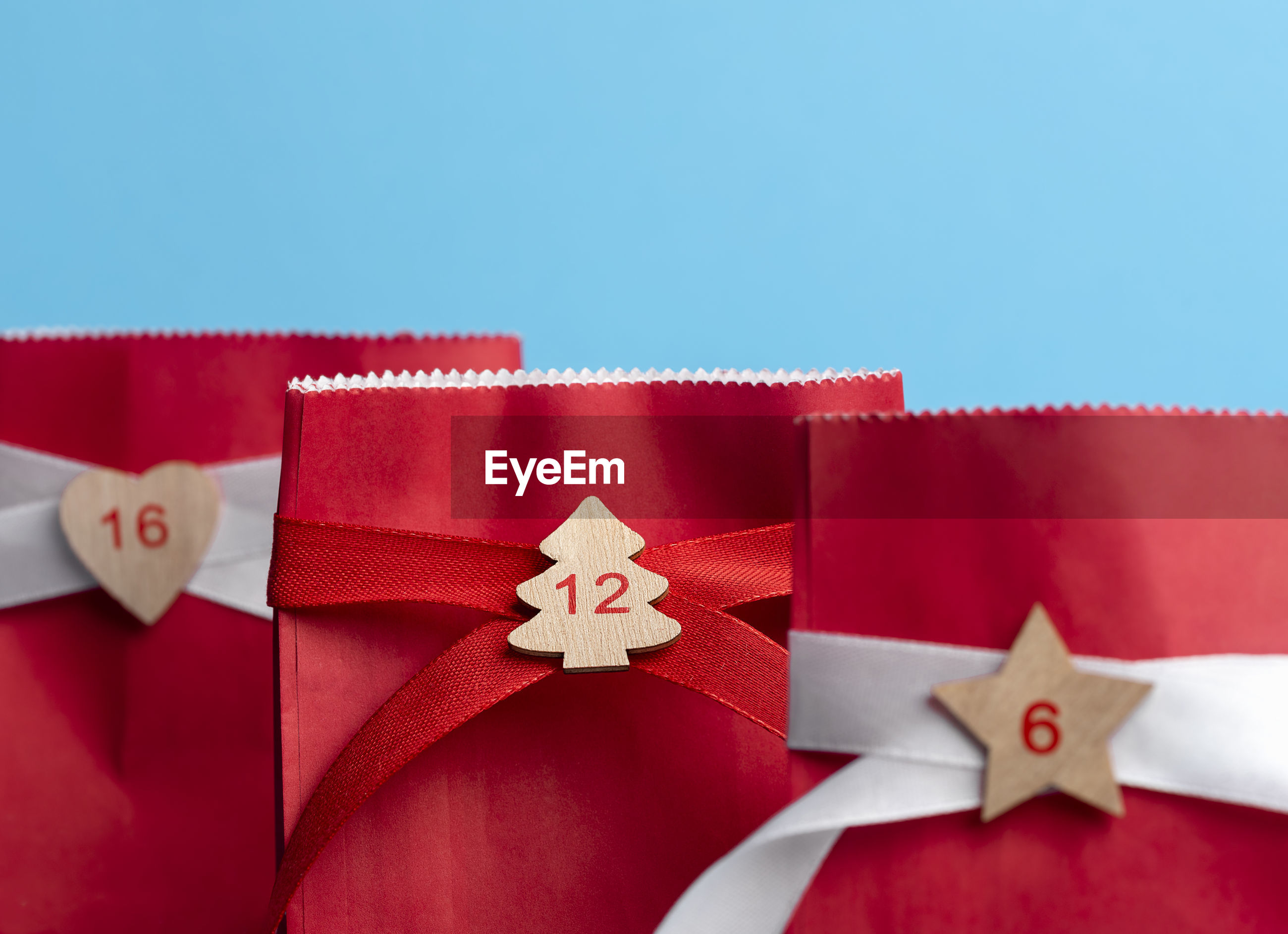Close-up of christmas gifts against blue background