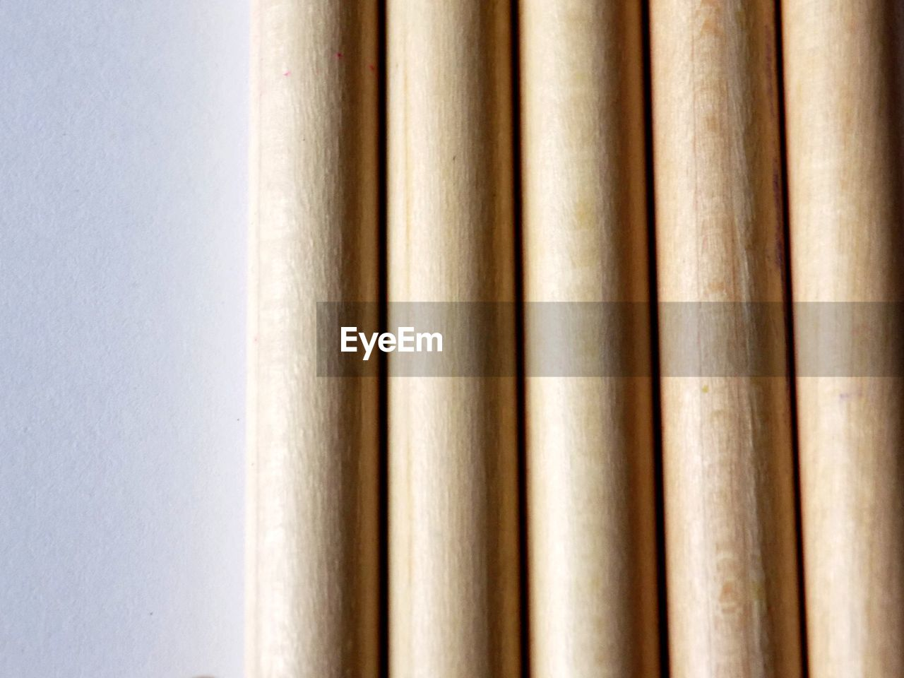 close-up, no people, backgrounds, indoors, studio shot, full frame, pattern, white color, white background, wood - material, in a row, still life, side by side, group of objects, day, brown, detail, architecture, paper, curtain, bamboo - plant