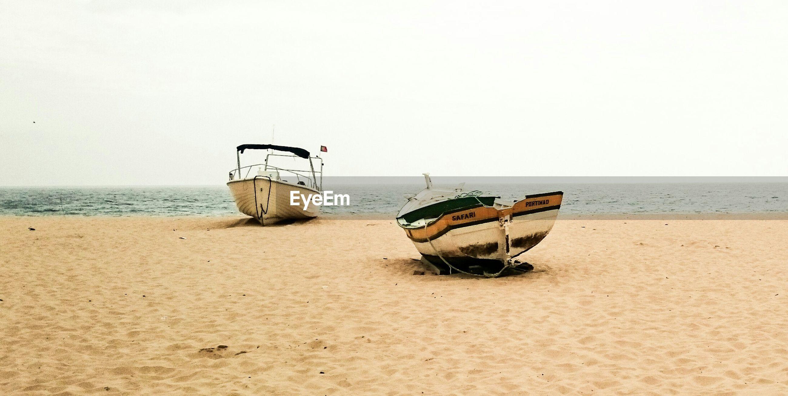 Boats on sandy beach