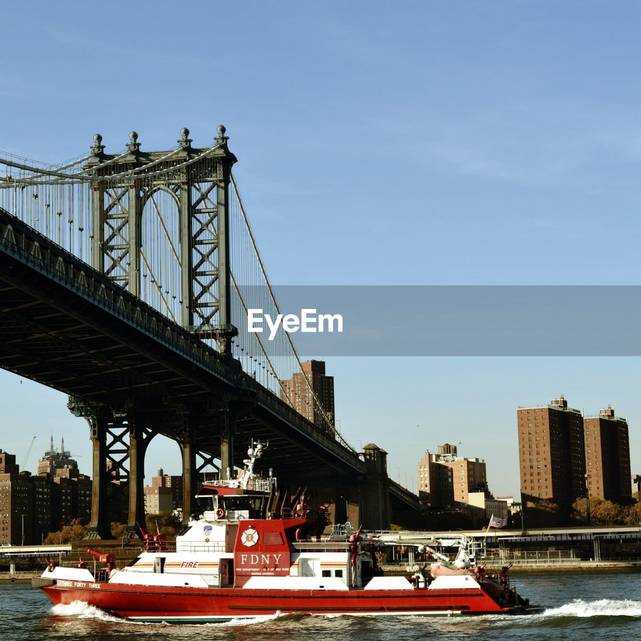 architecture, transportation, built structure, bridge - man made structure, connection, mode of transport, sky, outdoors, building exterior, day, land vehicle, city, nautical vessel, no people