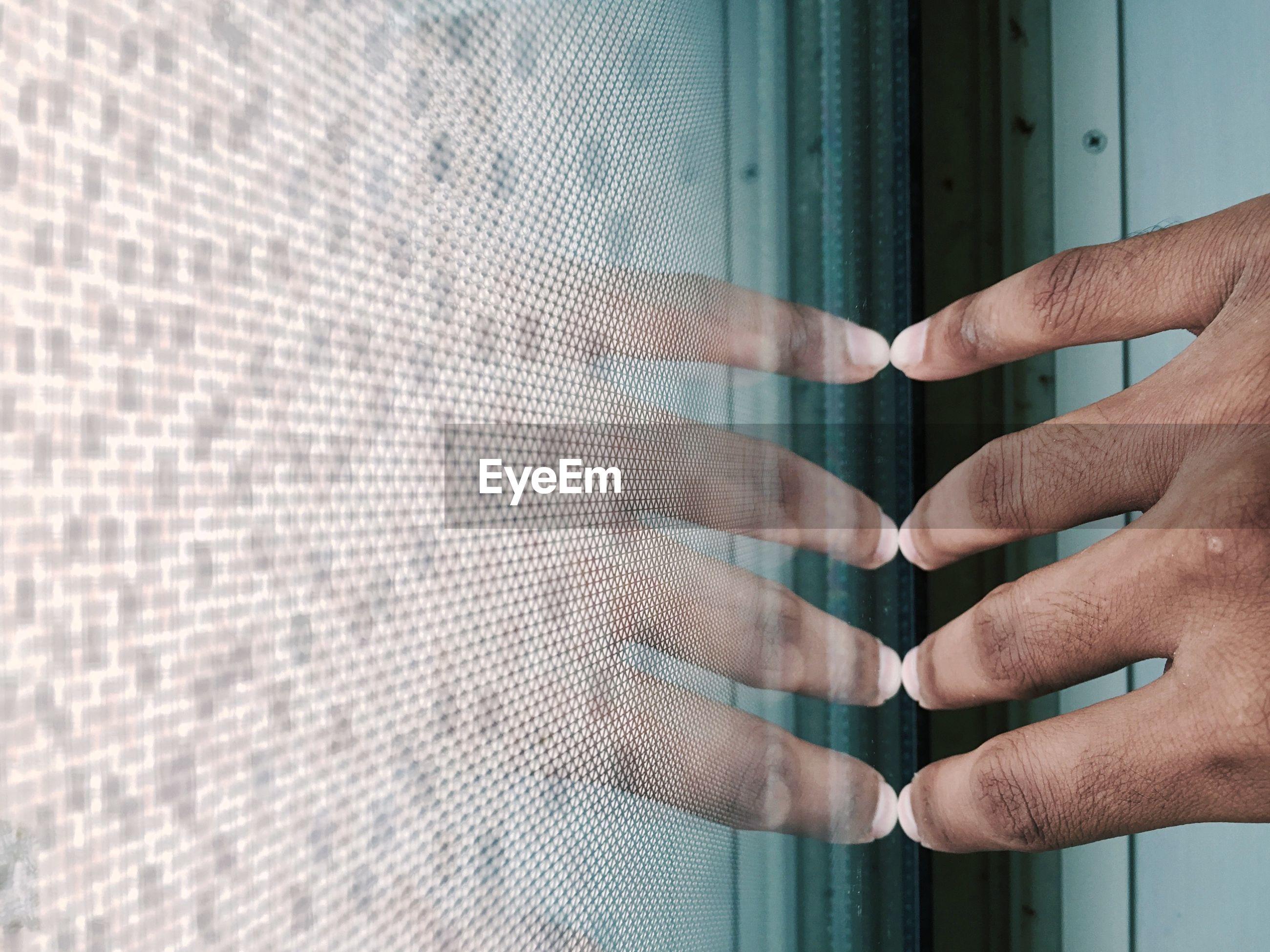 Close-up of man's hand touching futuristic screen