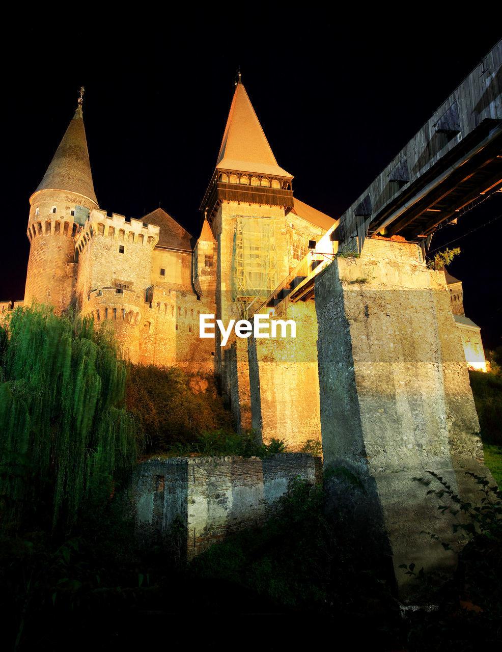 Illuminated corvin castle against blue sky
