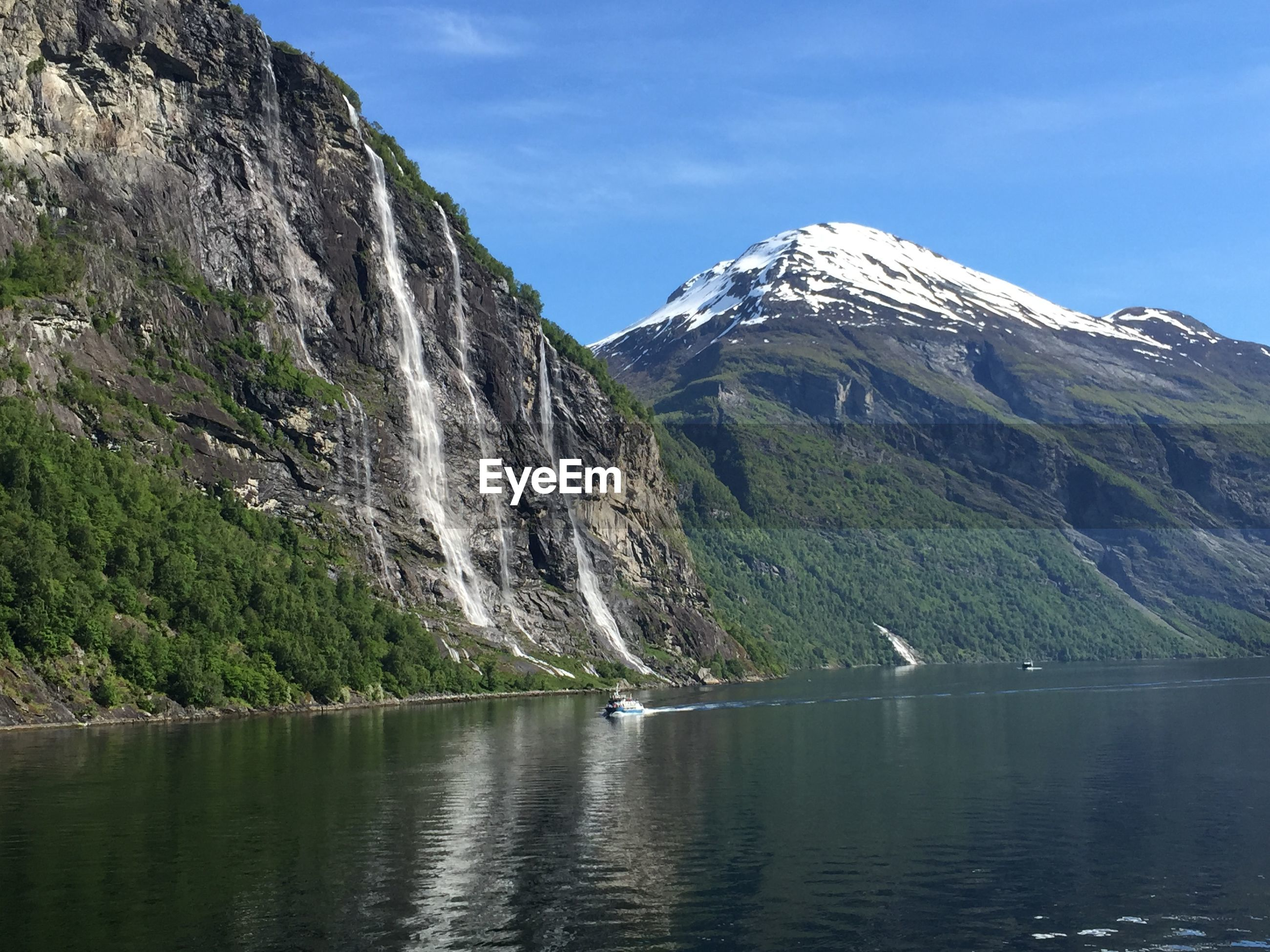 Majestic snow-capped mountains on fjord side