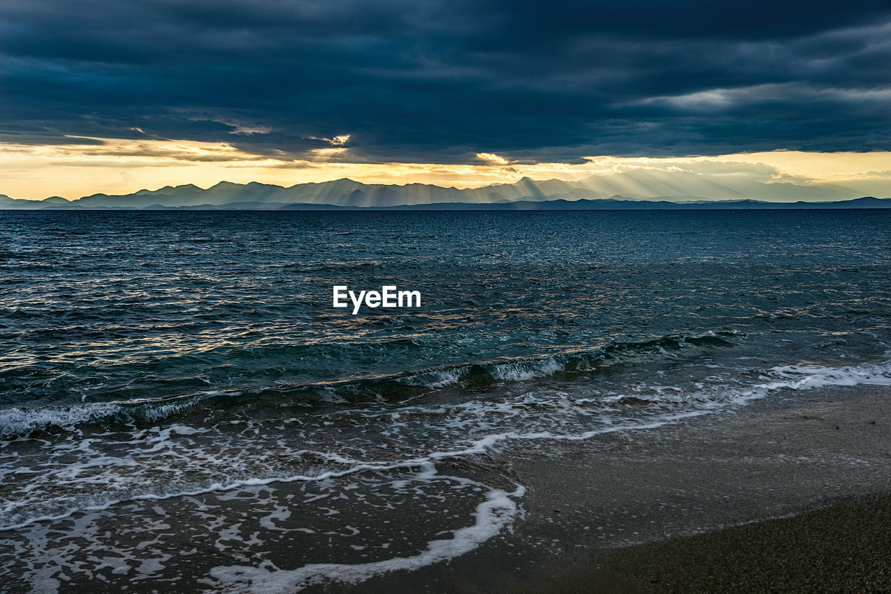 water, sky, cloud - sky, sea, beauty in nature, scenics - nature, sunset, beach, tranquil scene, land, nature, sport, tranquility, idyllic, aquatic sport, no people, motion, wave, outdoors, power in nature