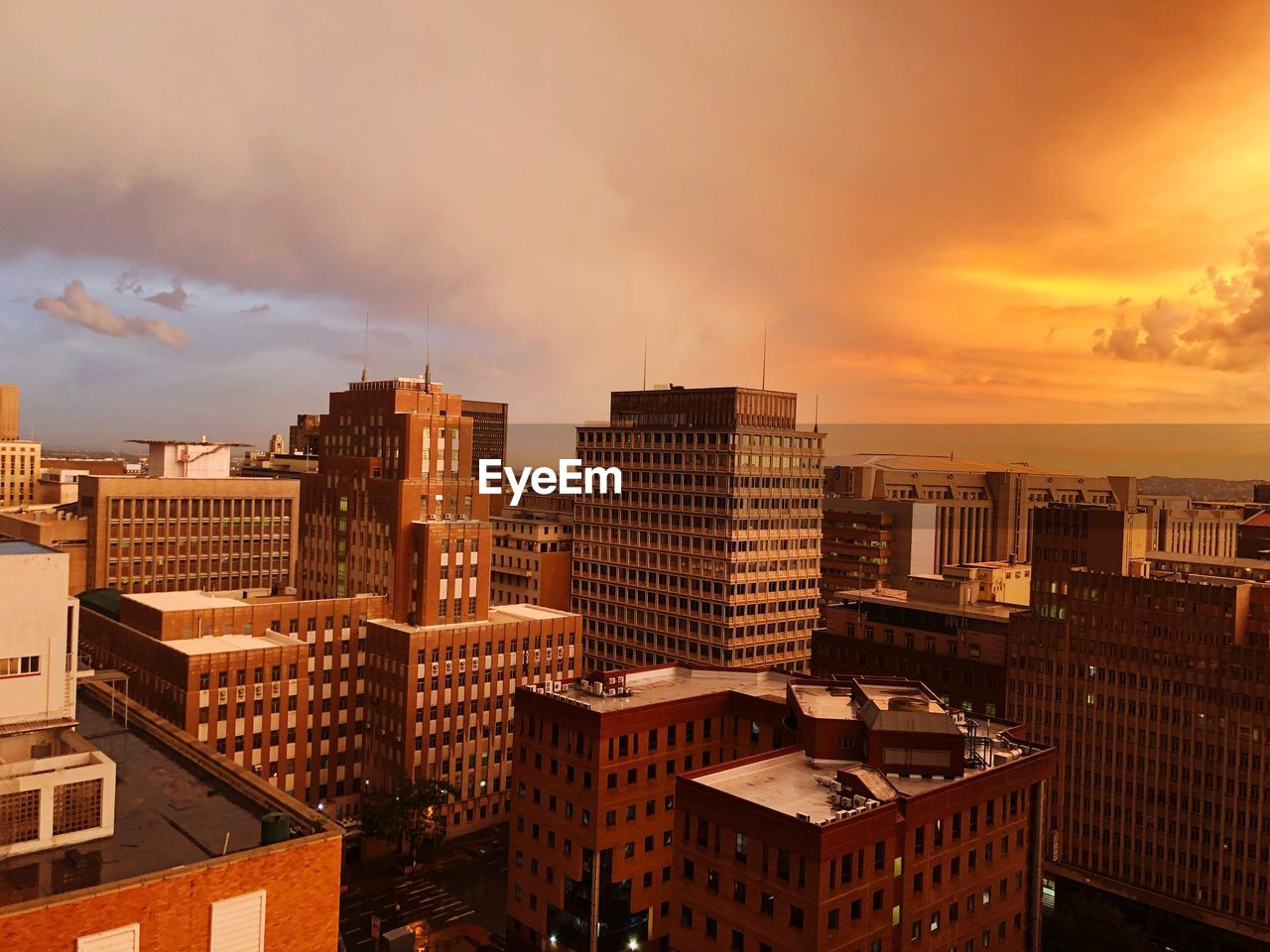 building exterior, architecture, built structure, sky, cloud - sky, city, building, sunset, nature, cityscape, residential district, no people, outdoors, orange color, sunlight, high angle view, office building exterior, skyscraper, apartment