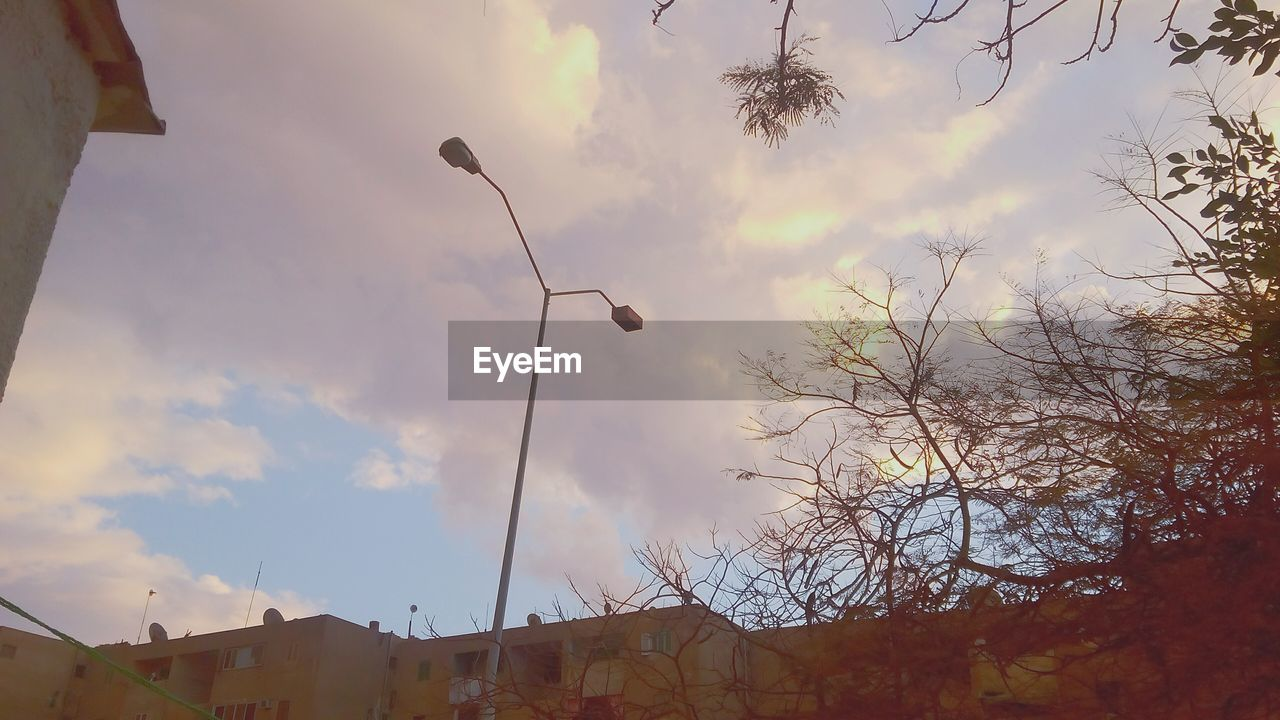 cloud - sky, built structure, sky, architecture, low angle view, building exterior, outdoors, no people, tree, day, nature