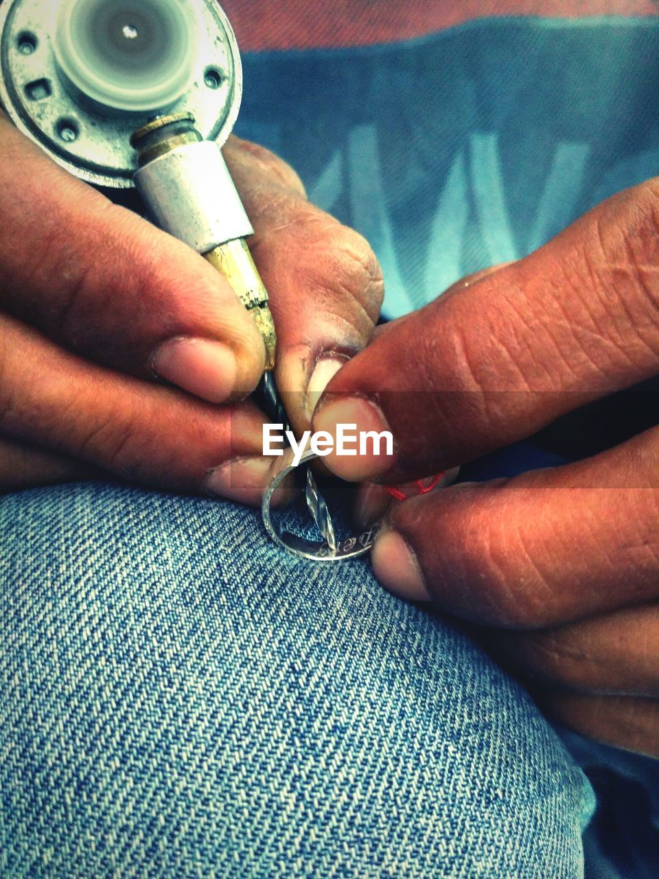 human hand, human body part, real people, working, sewing, two people, close-up, skill, indoors, machinery, occupation, holding, men, needle, day, adult, people