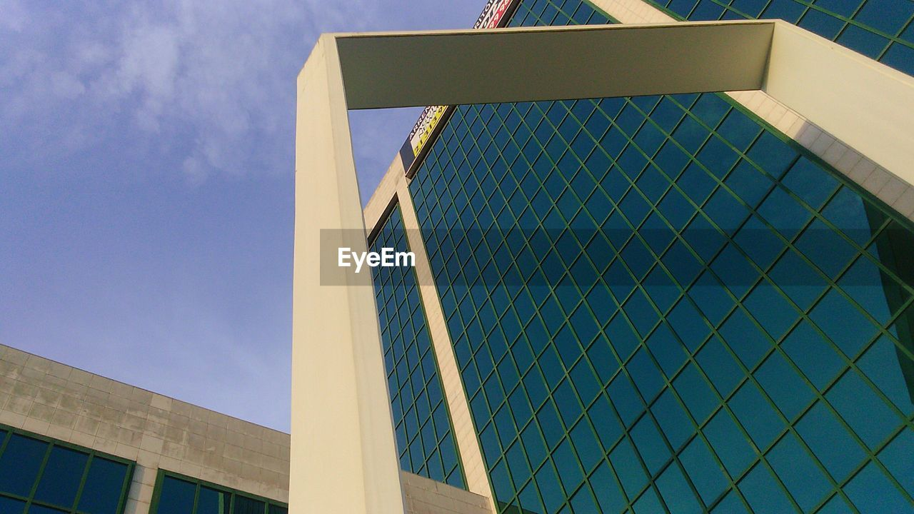 architecture, built structure, building exterior, low angle view, modern, day, no people, outdoors, sky, city