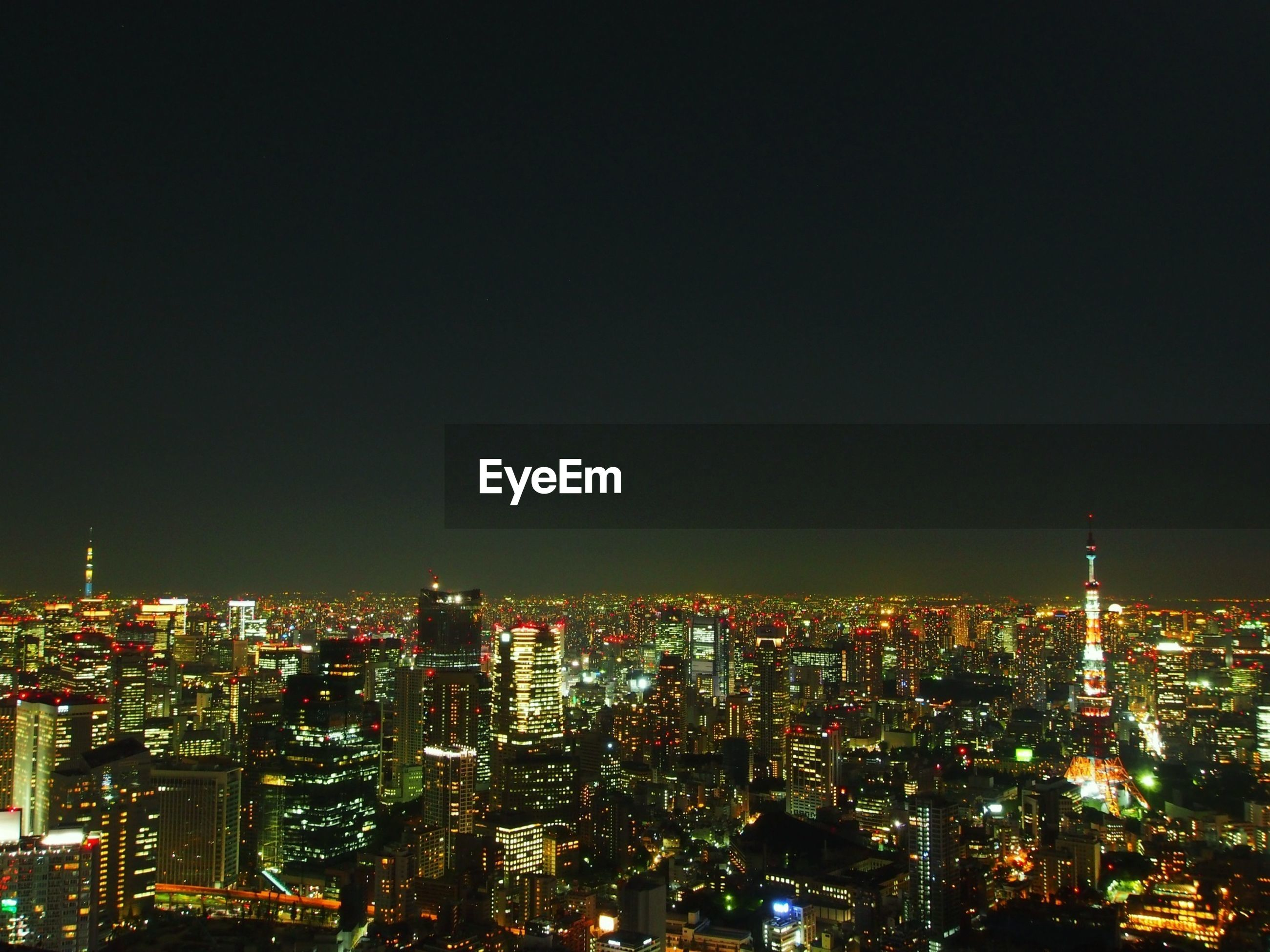 High angle shot of illuminated cityscape against clear sky