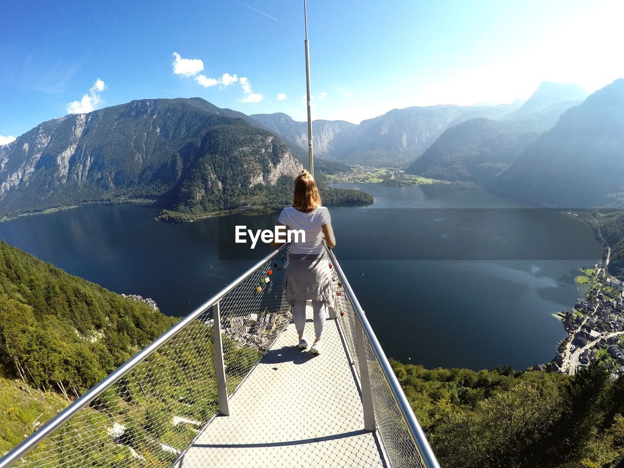 Rear View Of Woman Standing At Observation Point Against Sky