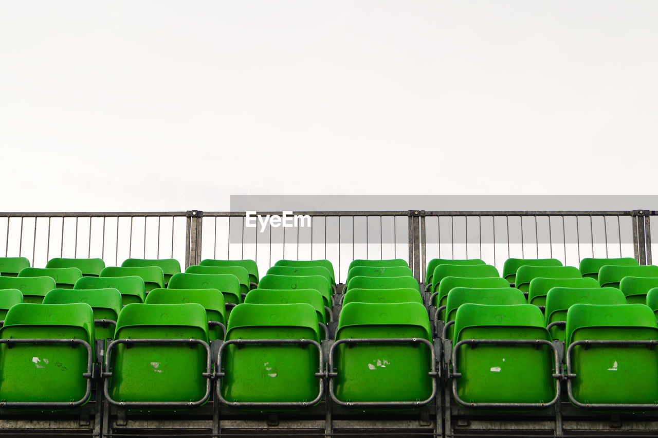 Green Bleachers At Stadium Against Clear Sky