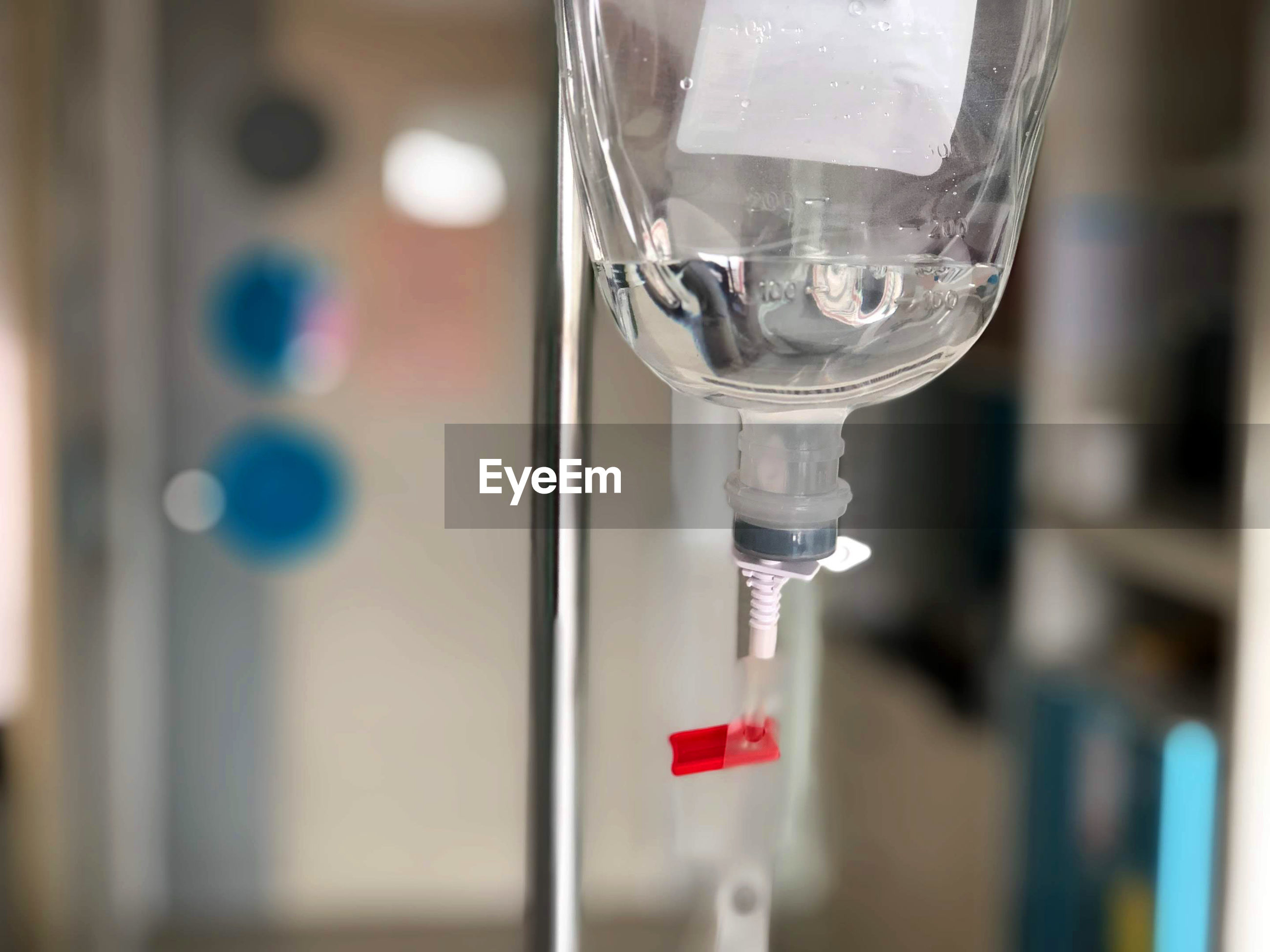 Close-up of iv drip hanging in hospital