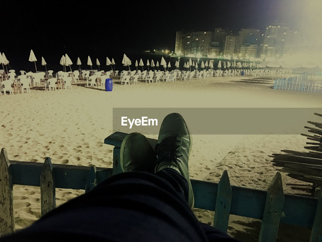human leg, low section, beach, sand, one person, real people, human body part, personal perspective, human foot, outdoors, shoe, leisure activity, sea, men, lifestyles, vacations, night, relaxation, building exterior, nature, water, architecture, one man only, sky, close-up, people