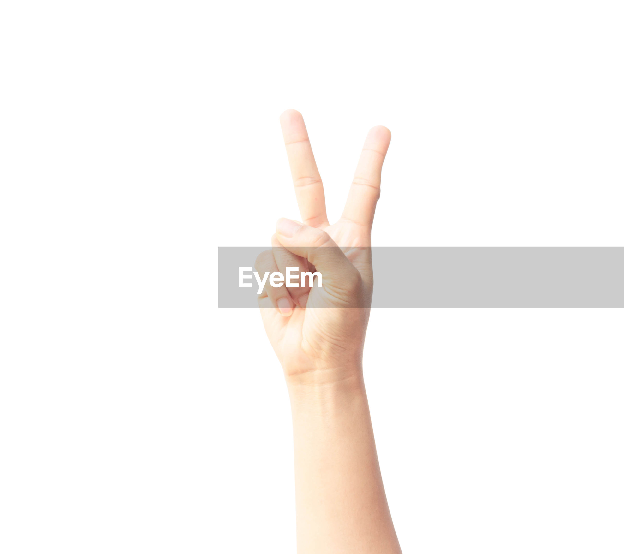 Cropped hand of person gesturing against white background