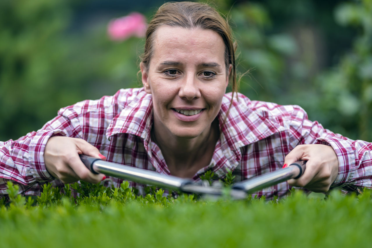 Mature woman gardening in lawn