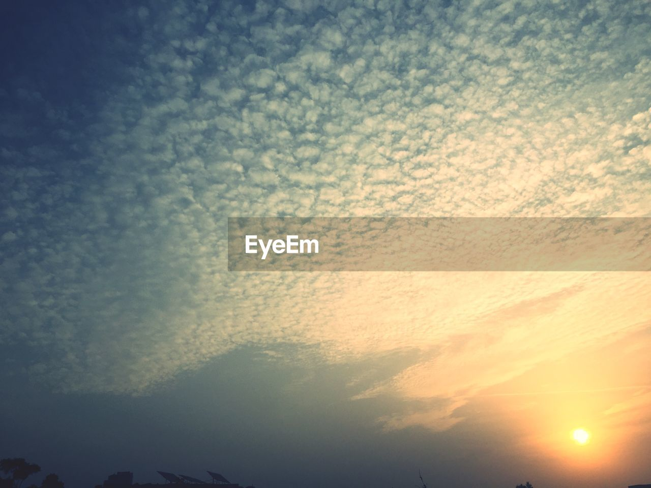 sky, cloud - sky, beauty in nature, low angle view, nature, no people, tranquility, scenics - nature, sunset, sunlight, tranquil scene, outdoors, backgrounds, day, idyllic, sun, full frame, orange color, silhouette, meteorology