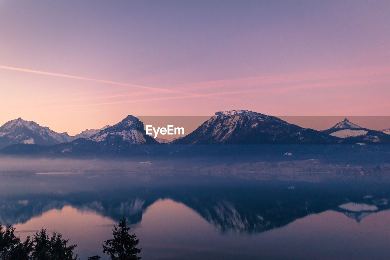 mountain, sky, beauty in nature, tranquility, scenics - nature, tranquil scene, sunset, mountain range, water, lake, idyllic, cold temperature, winter, nature, snow, reflection, no people, non-urban scene, snowcapped mountain, outdoors, mountain peak, reflection lake