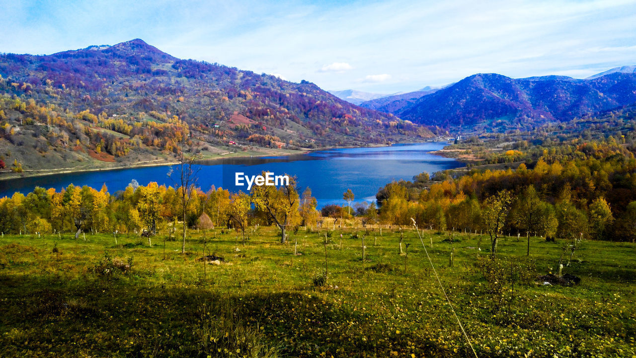 mountain, nature, beauty in nature, scenics, tranquil scene, lake, tranquility, mountain range, no people, sky, water, day, landscape, grass, outdoors, cloud - sky, scenery, tree, range