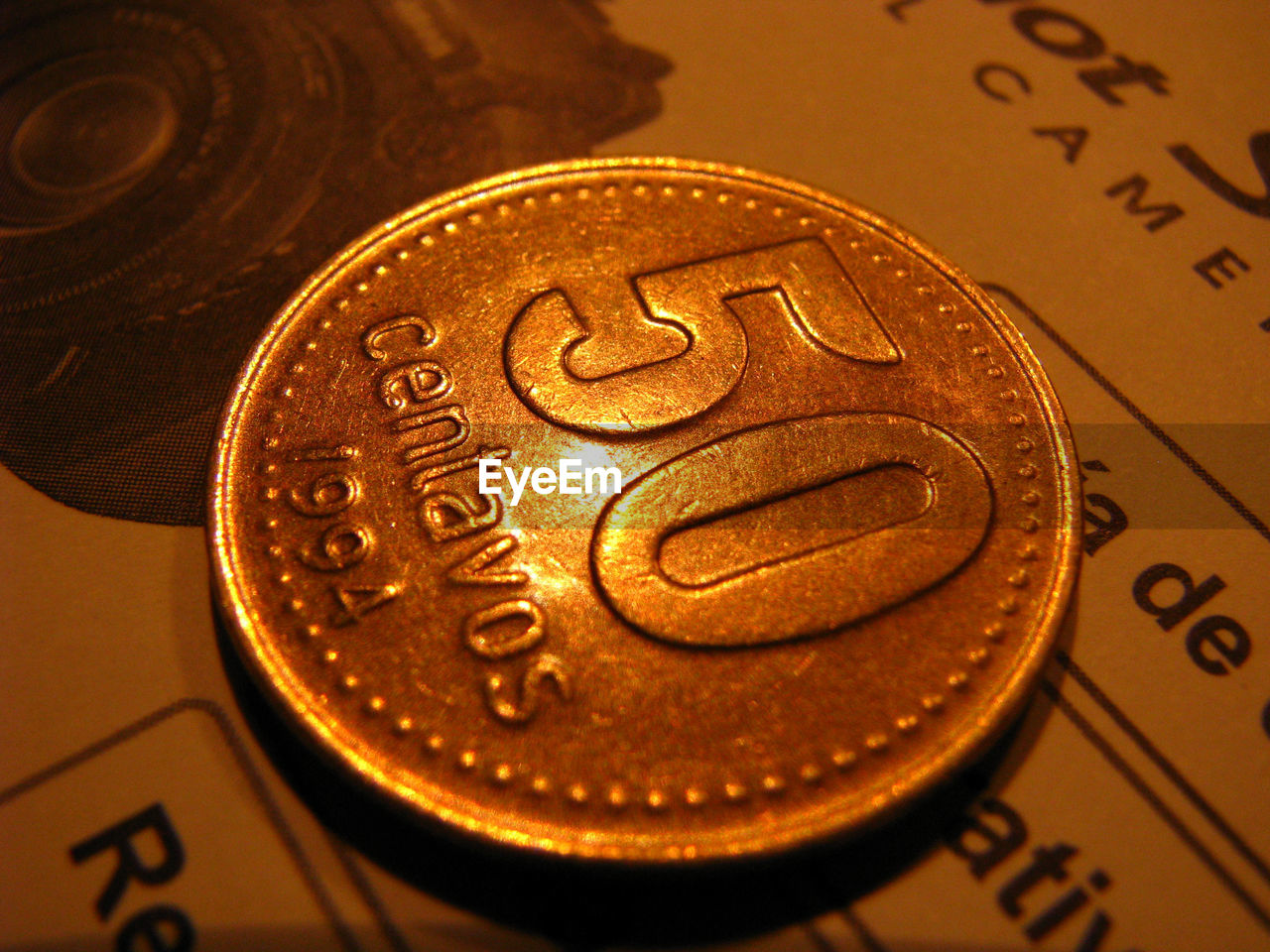 Close-Up Of 50 Centavos Coin On Paper