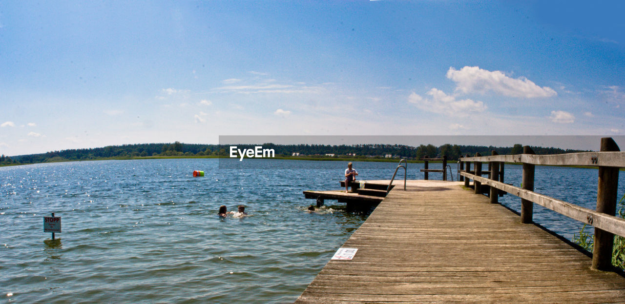 water, pier, wood - material, sky, day, nature, jetty, lake, tranquility, outdoors, beauty in nature, tranquil scene, scenics, cloud - sky, leisure activity, built structure, men, wood paneling, real people, people
