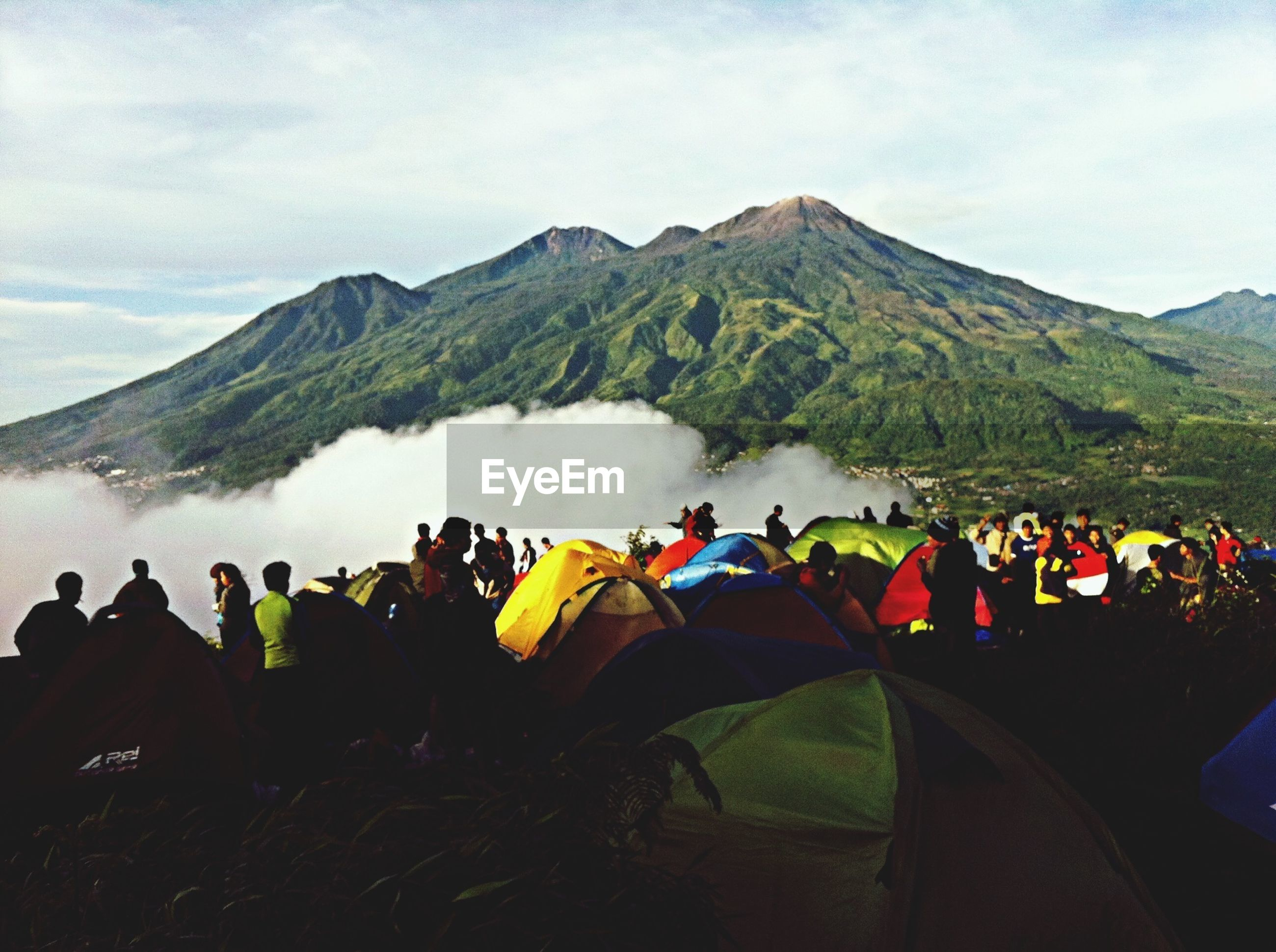 mountain, large group of people, mountain range, sky, landscape, men, lifestyles, cloud - sky, leisure activity, scenics, person, nature, tranquil scene, day, tranquility, beauty in nature, outdoors, tourism, vacations