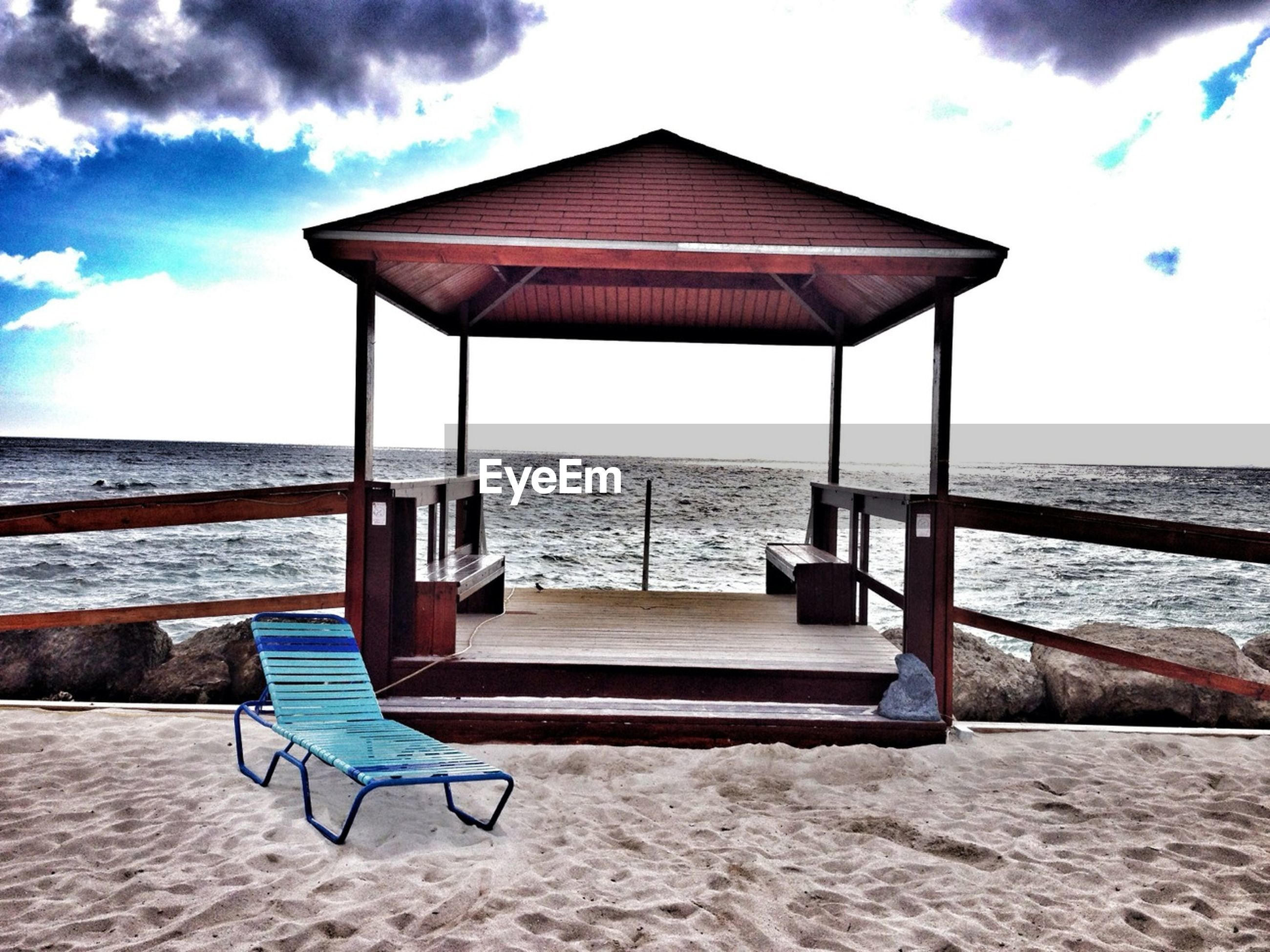 sea, beach, sand, sky, absence, water, chair, horizon over water, empty, shore, tranquil scene, tranquility, scenics, deck chair, lounge chair, relaxation, beach umbrella, parasol, nature, vacations