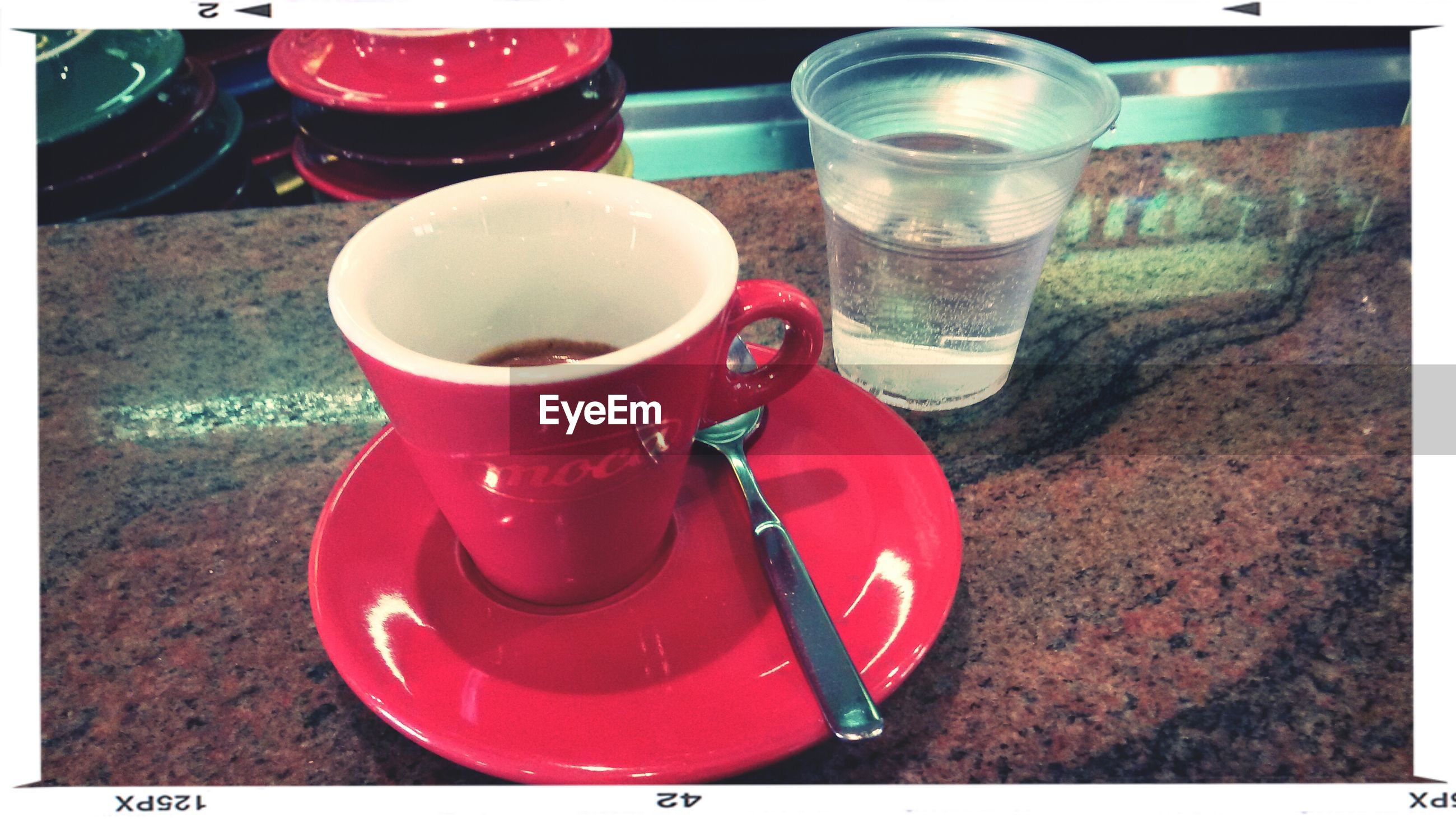 drink, transfer print, refreshment, food and drink, still life, auto post production filter, table, coffee cup, red, close-up, indoors, coffee - drink, cup, high angle view, saucer, freshness, no people, coffee, drinking glass, day