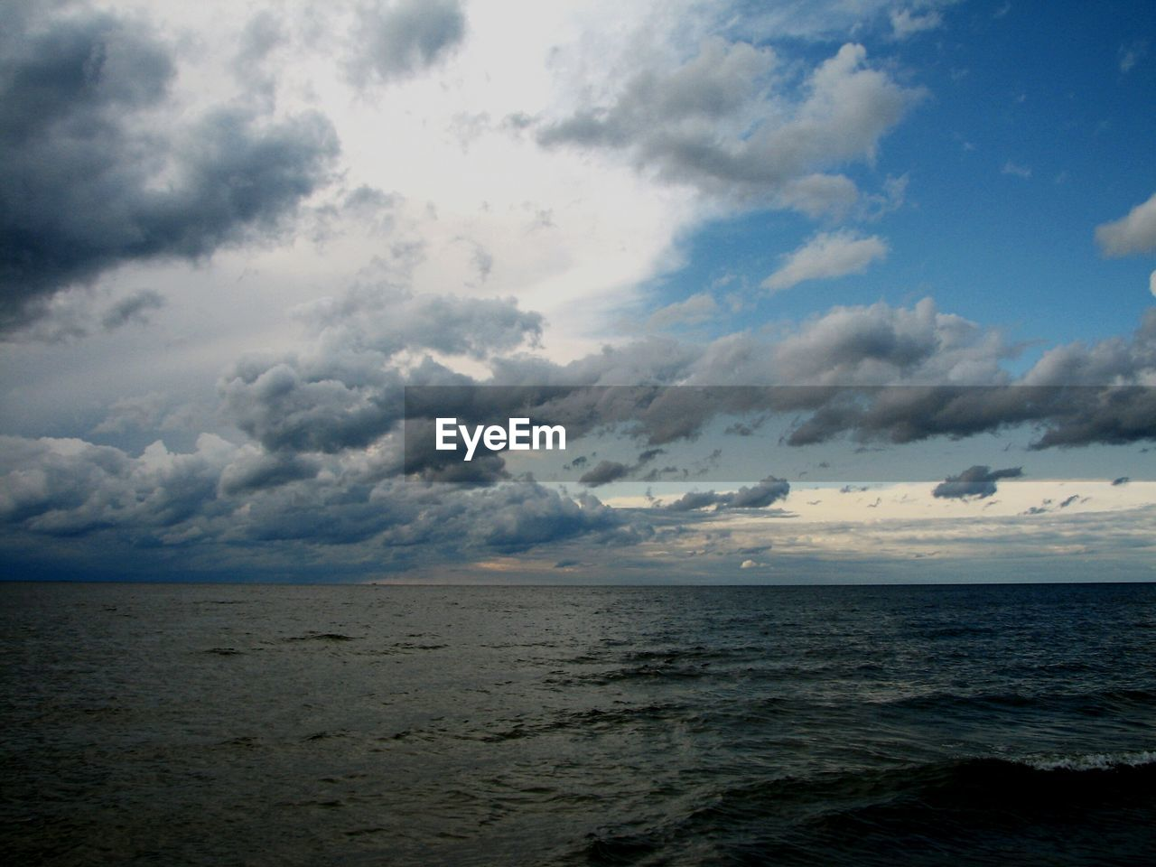 sea, horizon over water, sky, beach, beauty in nature, scenics, nature, water, tranquil scene, cloud - sky, tranquility, no people, outdoors, horizon, landscape, day
