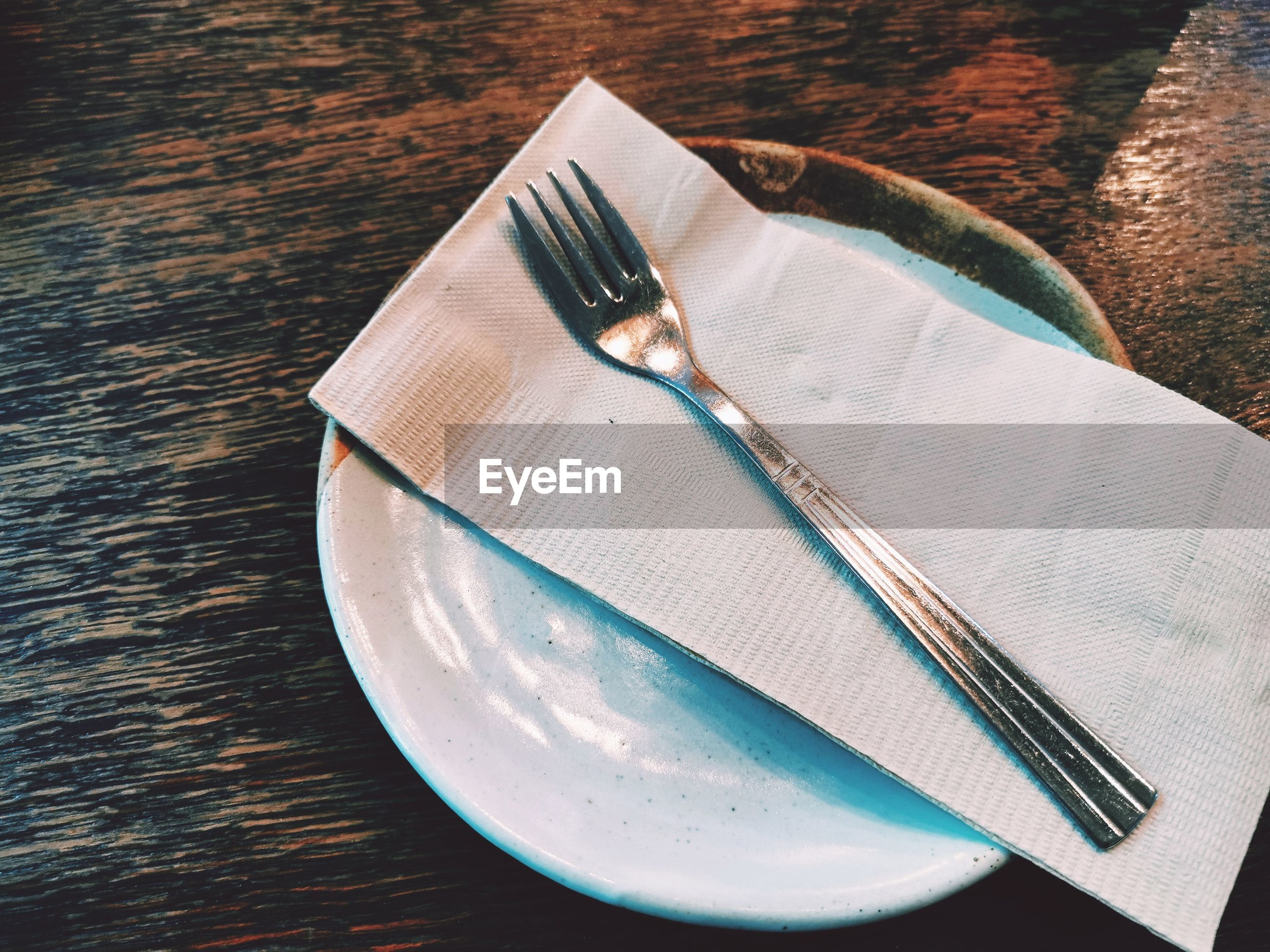 High angle view of tissue paper in plate on table