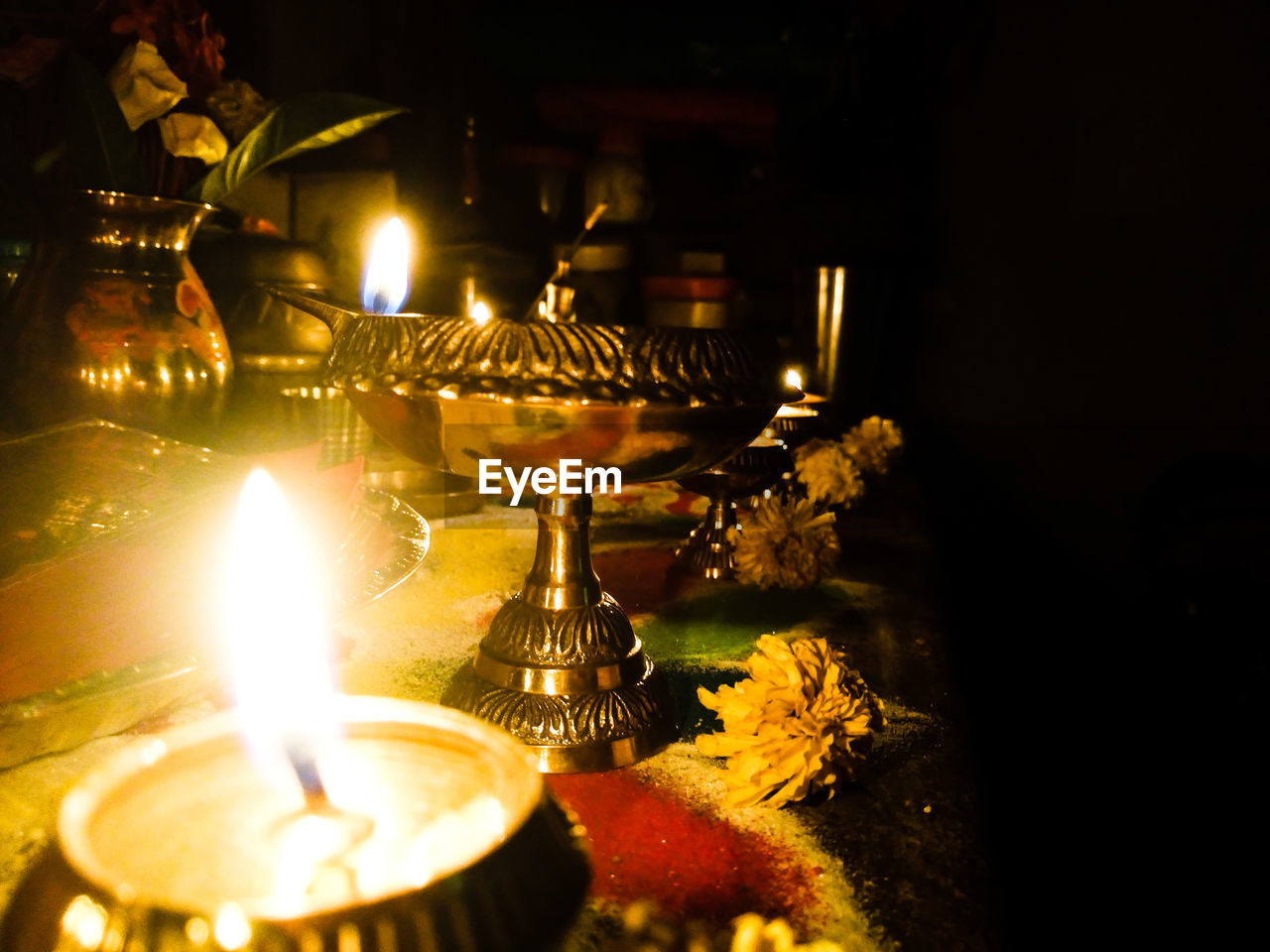 burning, flame, illuminated, fire, heat - temperature, candle, fire - natural phenomenon, no people, indoors, glowing, lighting equipment, close-up, religion, night, nature, belief, table, spirituality, selective focus, oil lamp, dark, electric lamp, tea light, altar