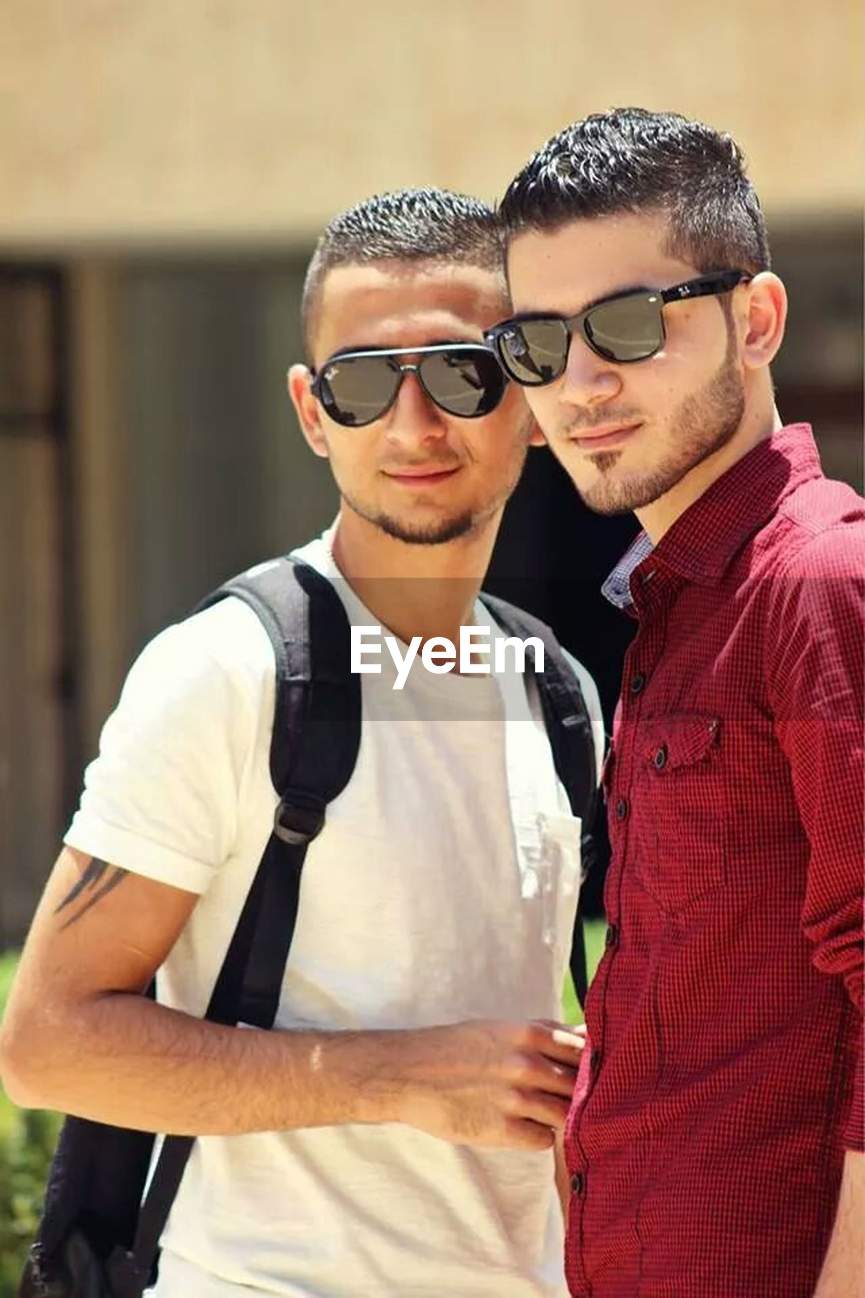 lifestyles, looking at camera, portrait, front view, person, young men, young adult, sunglasses, leisure activity, casual clothing, smiling, focus on foreground, eyeglasses, mid adult men, holding, waist up, happiness, mid adult