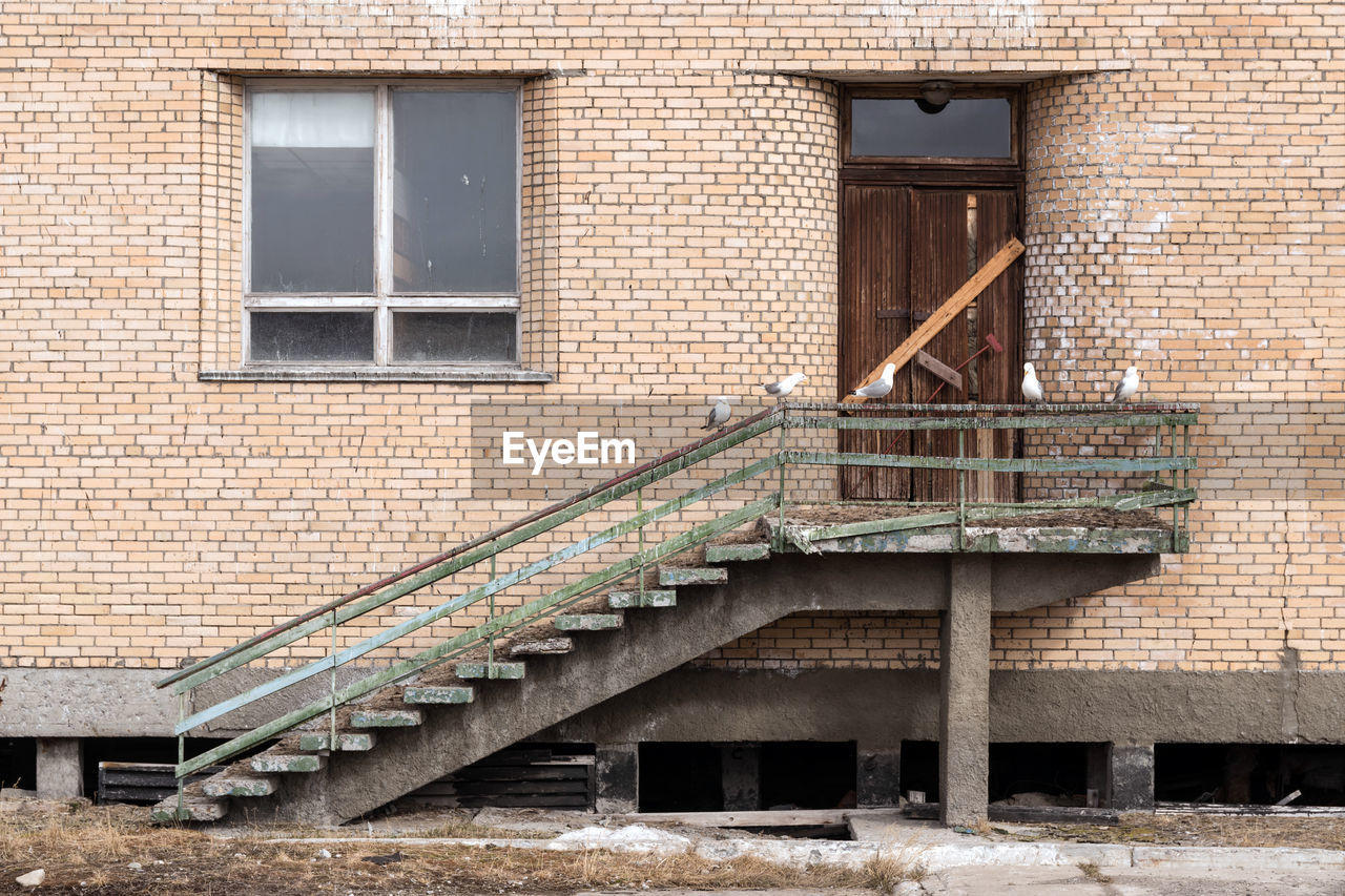 architecture, built structure, building exterior, window, brick wall, staircase, steps, steps and staircases, outdoors, no people, day