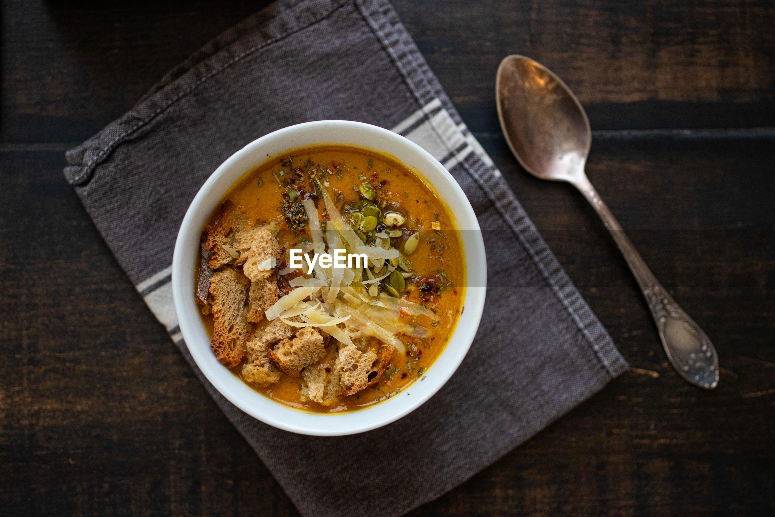 HIGH ANGLE VIEW OF SOUP ON TABLE