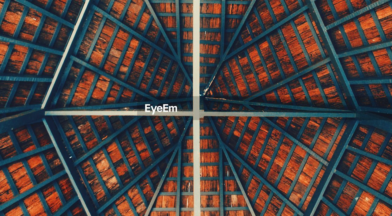 Low angle view of ceiling in building- geometric pattern