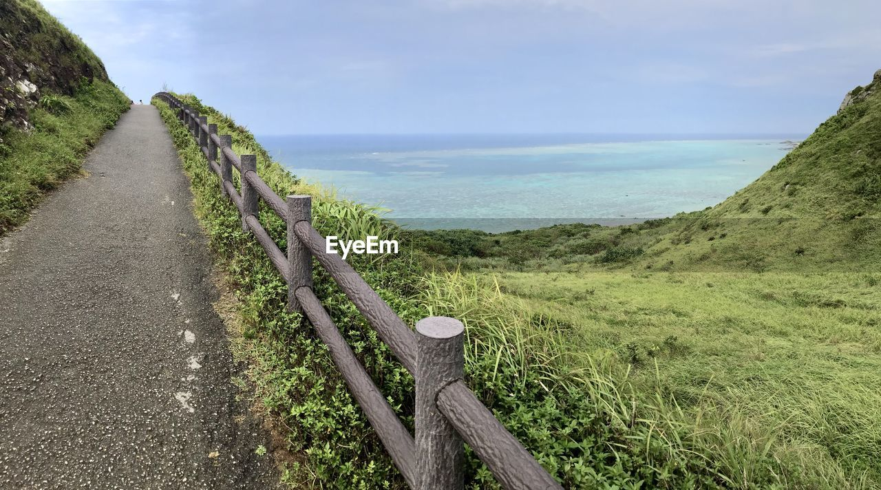 PANORAMIC VIEW OF SEA AND LAND AGAINST SKY