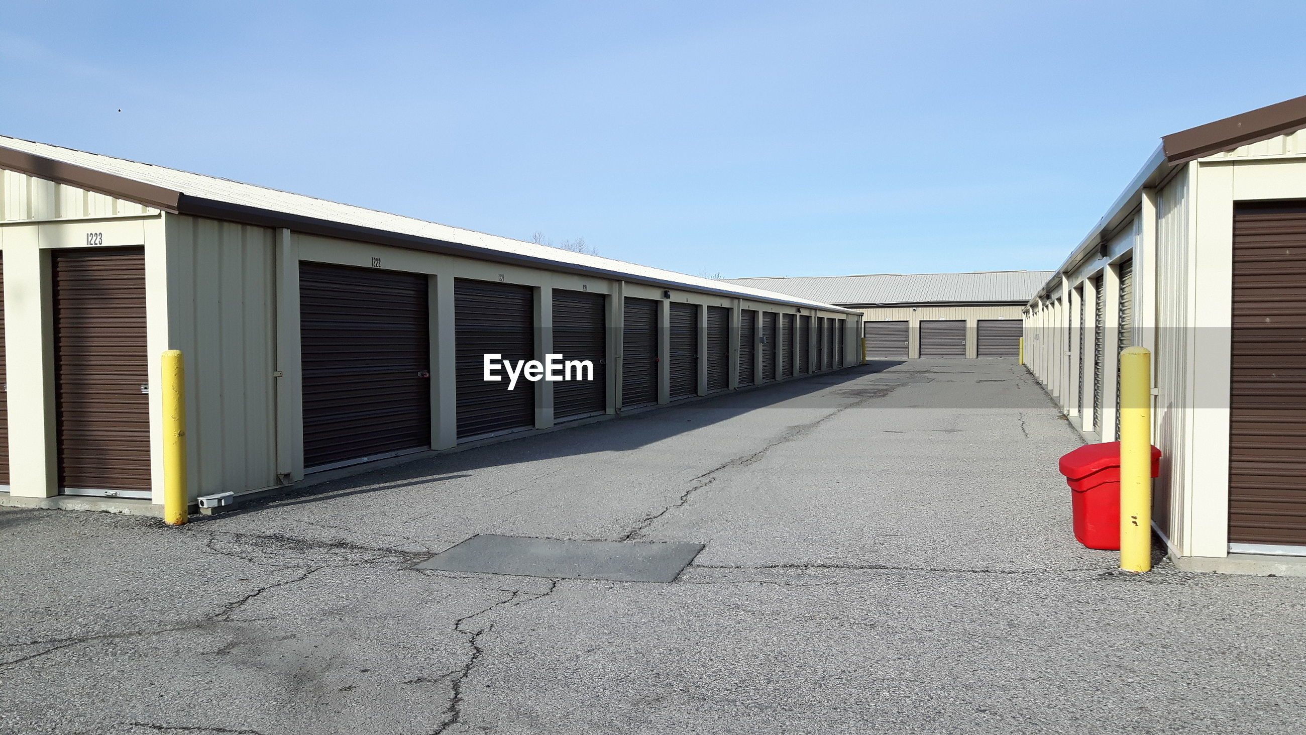 Exterior of warehouses against clear sky