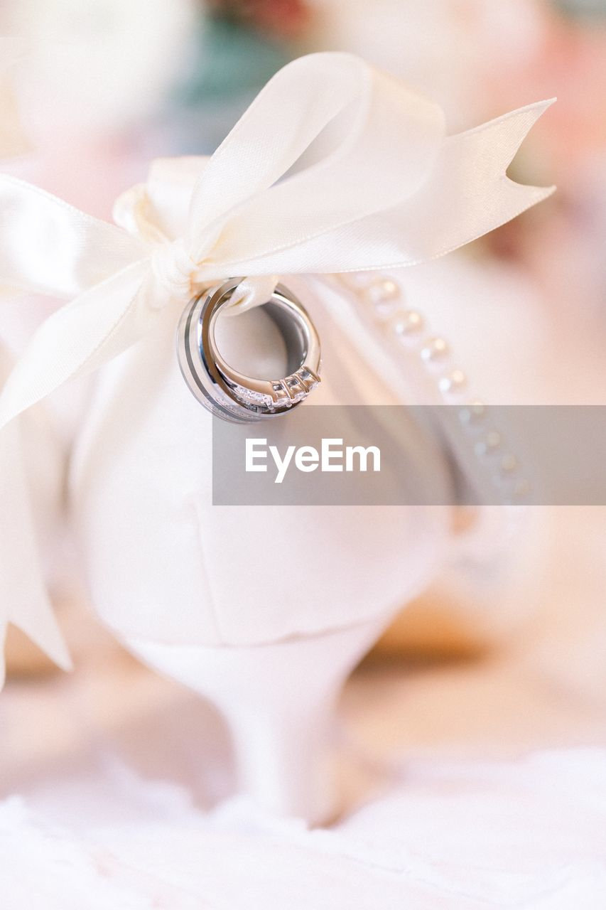 jewelry, close-up, ring, no people, still life, wedding, white color, celebration, diamond - gemstone, focus on foreground, event, fashion, life events, indoors, wedding ring, ribbon, selective focus, love, rose, ribbon - sewing item, personal accessory, pearl jewelry, luxury