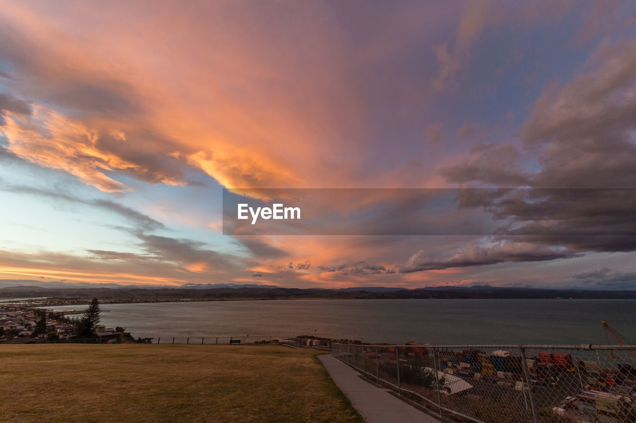 cloud - sky, sky, sunset, built structure, scenics, nature, architecture, sea, outdoors, the way forward, water, beauty in nature, no people, horizon over water, building exterior, day