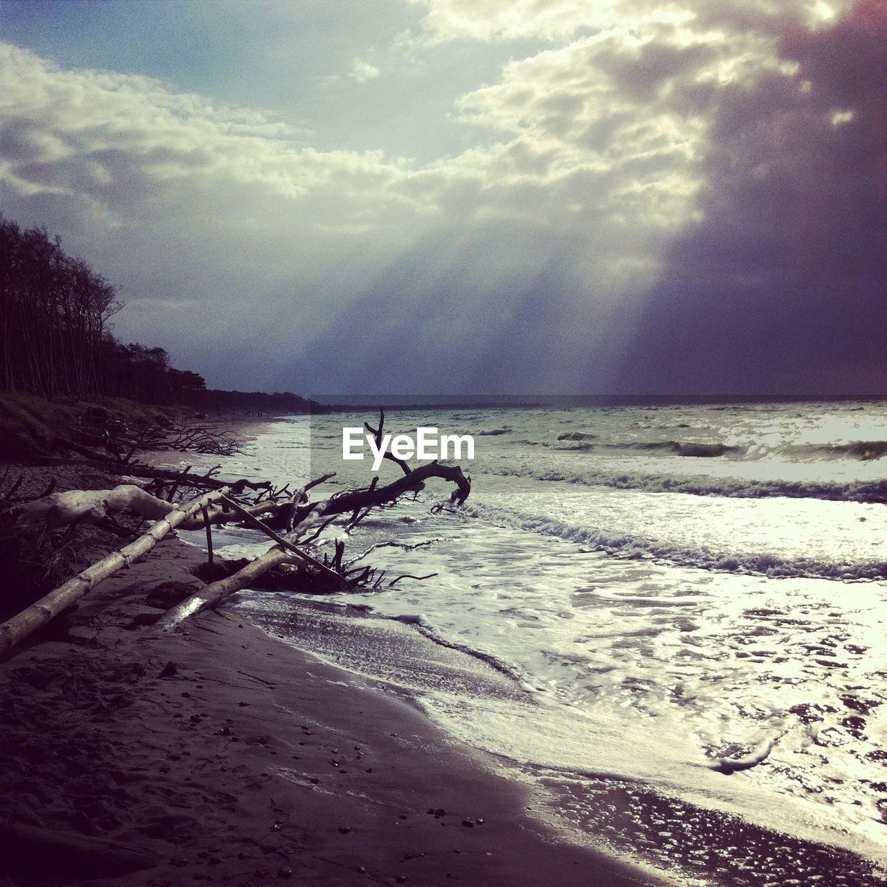 Sunbeams falling over beach