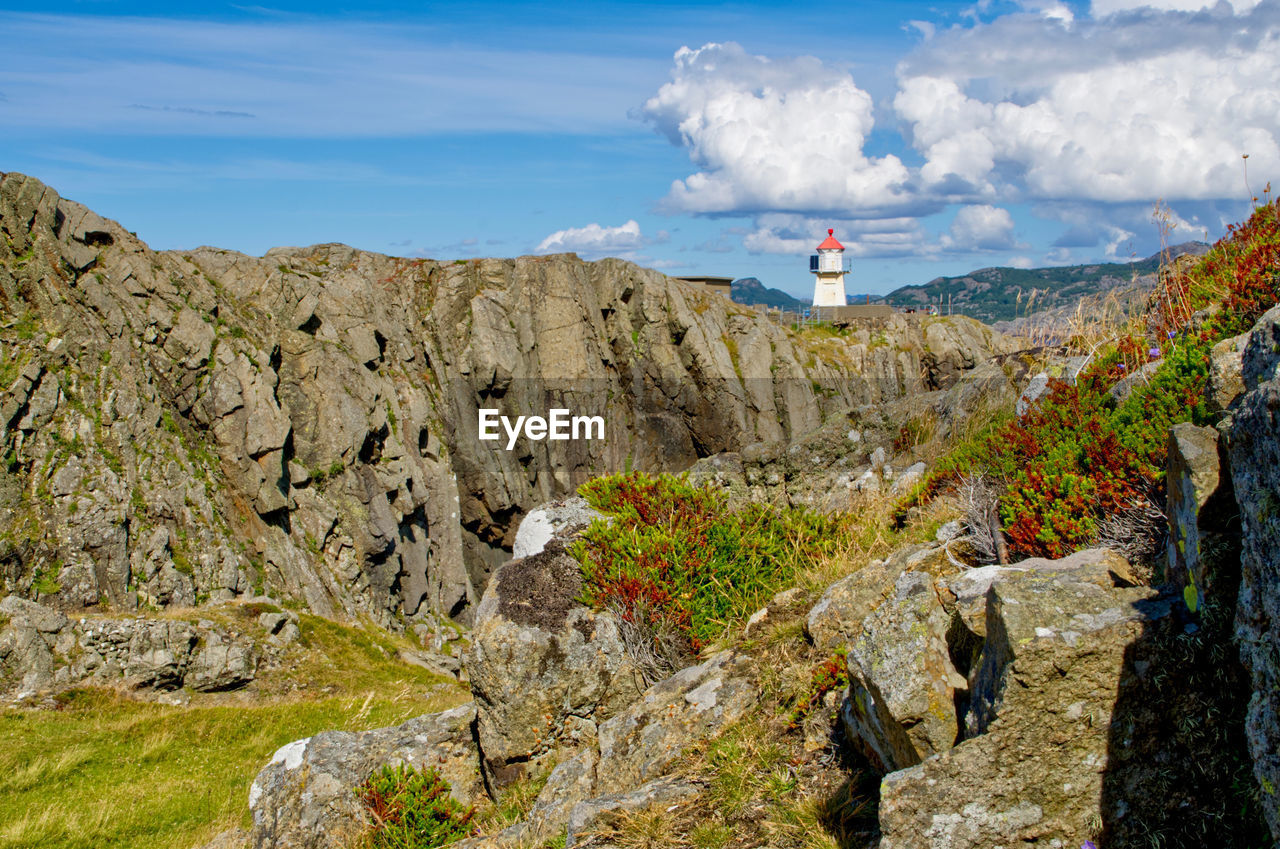 SCENIC VIEW OF ROCKS ON LAND AGAINST SKY