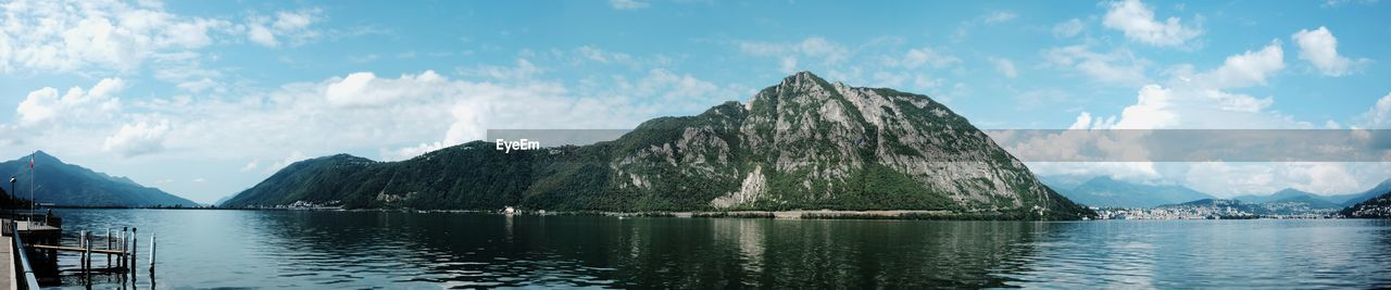 mountain, sky, water, cloud - sky, beauty in nature, scenics - nature, tranquility, mountain range, tranquil scene, nature, lake, panoramic, reflection, non-urban scene, waterfront, no people, day, outdoors, idyllic, mountain peak